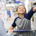 Little boy shops with mom in hardware store