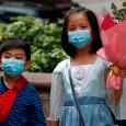Children wear face masks, following the outbreak of the novel coronavirus on Valentine's Day in Hong Kong